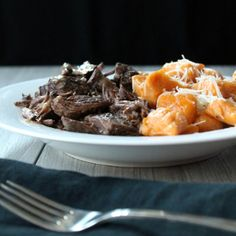 Slow Cooker Beef Short Ribs + Sweet Potato Gnocchi--Delicious! Reduce the juices down and top with thyme.