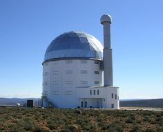 Southern African Large Telescope (SALT) - The Southern African Large Telescope (SALT) sits high atop ancient volcanic boulders, four hours from Cape Town. The telescope, billed as Africa's giant eye on the universe, is a time-domain spectroscopy allowing astronomers to take photos of stars in very quick succession by using its digital camera known as the salticam.