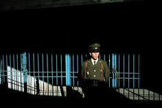 A policeman stands guard at a stadium where Pinochet held pro-Allende supporters. David Alan Harvey, Magnum Photos, National Geographic, Chile, People, Color, Santiago, Colour, People Illustration