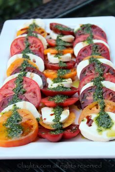 Easy recipe for homemade tomato and mozzarella caprese salad with balsamic vinegar reduction and basil garlic oil. Pesto Dishes, Veggie Dishes, Ensalada Caprese, Caprese Salad, Tomato Salad Recipes, Healthy Salad Recipes, Antipasto, Tomato Mozzarella Caprese, Anti Pasta Salads