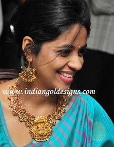 Gold and Diamond jewellery designs: nakshi gold necklace set