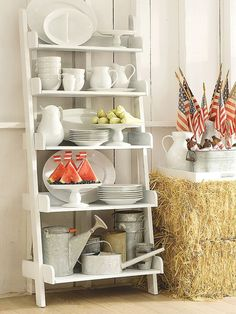 Ladders can be used for more than just reaching that hard-to-reach shelf. If you have an old wooden ladder that you aren't sure what to do with anymore, hang it on the wall and use the ladder to display decorative items like pictures.
