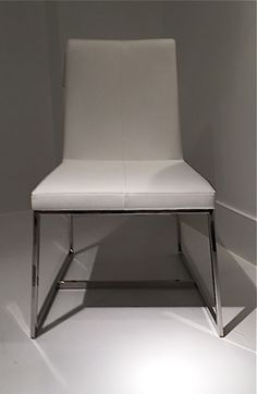 EGYPTO ... Dining Chair. Stainless Steel splayed sled base. Mfg; WHITELINE. Design; Stanley Jay Friedman.