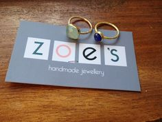 These rings are from a shop in Hydra, an island about 1.5 hours from Athens. She doesn't have a website listed on her card but her email address is zoeshydra@yahoo.gr These rings are silver dipped in gold; the stones are aquamarine and blue agate and they cost €45-60
