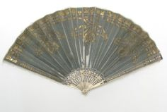 Fan, silk leaf with gilt and spangles, ivory sticks inlaid with silver, 1800-20.