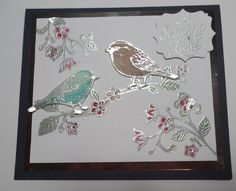 Hi, Elizabeth Shield here....I created this 3D birds on a  branch card using the new release Best Birds stamp set from Stampin' Up. I heat embossed the birds, flowers and branch in silver onto vellum and then coloured the vellum to add a touch of colour ad added diamantes to the centre of the flowers. I used a silver mat on top of the navy blue cardstock. The Sending Love sentiment comes from the new release Tin of Cards stamp set.   #handmadecard #stampinup #elizabethshield…