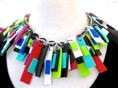 colorful felt strips with added felt pieces on each by BernsenArts