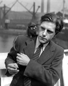 Gerald Durrell with a Guenon Moustached Monkey. 1949.