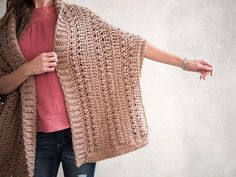 Designed with textured stitches and chunky yarn, this trendy shrug is the epitome of simplicity and style! Crochet Jacket, Crochet Poncho, Crochet Shrug Pattern Free, Crochet Cocoon, Shrug For Dresses, Happy Size, Crochet Hook Sizes, Chunky Yarn, City Chic