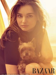 Girl's best friend: The model posed with a cute little dog inside Harper's Bazaar magazine