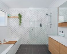 Scandi bathroom design and styling by Sapphire Living Interiors with herringbone tile feature wall, recessed shaving cabinet, floating vanity and open shelving