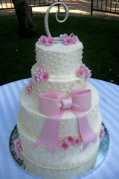 """My inner princess says """"HELL YES"""" to the sugar pearls, swirls and pink flowers and bow on this one! (Some Crust Bakery)"""