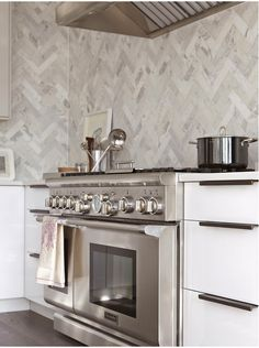 herringbone marble wall backsplash #kitchen