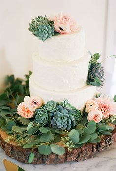 Brides: White Cake with Succulents & Roses. A three-tiered white wedding cake decorated with greenery, succulents, peonies, ranunculus, and dahlias arranged by florist Lilla Bello.