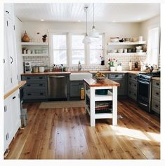 Love the floors, open shelving,farm sink, planked ceiling. Stove ventilation. Window ventilation up to code?