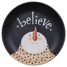 """You will certainly """"Believe"""" in the magic of the season with our Snowman Plate! This decorative plate is made from wood and has been painted black with the illustration of a skyward-looking snowman wearing a cozy scarf. Primitive Folk Art, Primitive Christmas, Country Primitive, Rustic Christmas, Primitive Plates, Primitive Decor, Painted Plates, Wooden Plates, Pottery Plates"""