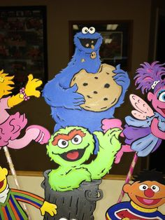 Sesame Street Birthday Centerpiece with Cookie Monster, Bert, Ernie, Oscar the Grouch, Elmo, Zoe and Abby Cadabby for Sesame Street Party