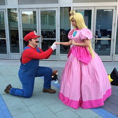 Mario serenades Princess Peach at this cosplay convention.
