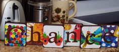The Very Hungry Caterpillar Themed Custom Name Blocks - this would not be hard to do!