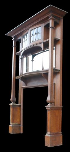 Large antique Arts & Crafts oak fireplace surround.