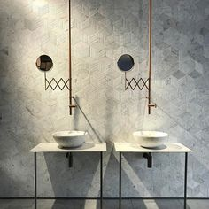 Two basins are always better than one. Marble glad walls and that interesting tap and mirror column.