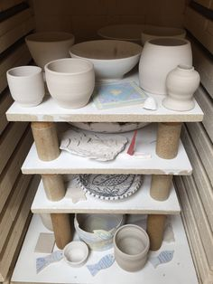 Lynda-Anne Raubenheimer - Student work bisque firing with one or two of my porcelain bowls in between
