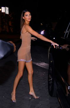 Kendall Jenner in a nude minidress and Amina Muaddi Begum pumps (clear shoes) in Miami. model Kendall Jenner Wears Amina Muaddi Heels in Miami Celebrity Fashion Outfits, Celebrity Style Dresses, Celebrity Style Casual, Celebrity Style Inspiration, 90s Fashion, Celebrity Women, Miami Fashion, Classy Fashion, Fashion Clothes