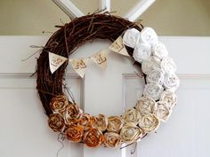 Wicker wreath with fabric flowers and bunting