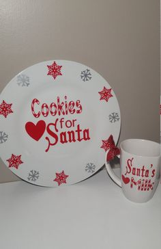 This cookie and milk set will be the perfect added touch to your Christmas eve traditions. Put some cookies and milk out for santa on this cute handmade plate and cup set!  High quality red and silver vinyl is used. A crafty candy cane font and cute snowflakes are designed on set!  Handwashing gently is recommended :)