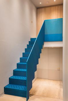 Staircase, Metal Railing, and Metal Tread The eye-catching metallic blue staircase was produced by Joe Faller Fabrications. Photo 8 of 17 in A London Penthouse Is Flooded With Dreamy Shades of Blue Staircase Metal, Metal Railings, Modern Staircase, Staircase Design, Staircase Ideas, Open Basement Stairs, Basement Ideas, Basement Flooring, Laminate Flooring