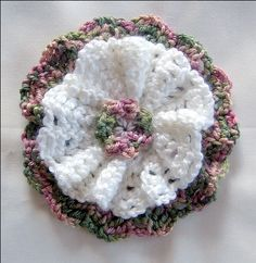 A Button Flower can be added to almost everything you crochet. Full free instructions here.