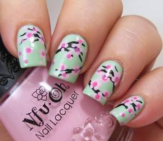 Though cherry blossom season is long gone, you can still wear the pretty petals on your nails. Even better, this manicure is super easy — add a few dots and squiggly brown stripes and you're good to go. Get the tutorial from Did My Nails »  - GoodHousekeeping.com