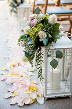 Lantern and floral aisle decor at a Disneyland Wedding at Parkview Terrace