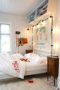 Love the vintage map and light headboard! Be sure you choose low heat LED lights if you try something similar