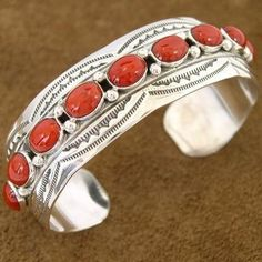 Bracelet with hand cut cabochons of genuine Bamboo Coral from the China Sea. A Sterling Silver casing was wrapped around each Coral cab and then it was sweated to the shining Sterling Silver cuff. #Alltribes