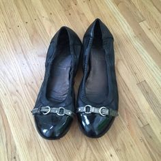 AGL black leather flats Black leather AGL flats with silver buckle detail. These are timeless classics. They've been worn (as you can see) but are still very wearable. Please note there is a scratch on the patent toe cap of the right shoe. AGL Shoes Flats & Loafers