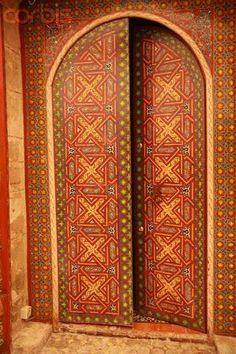 beautiful doors ... intricate designs in oranges and olives ..