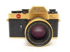 The Leica Gold with 50 lens. These were produced in 1979 to commemorate the birthday of Oskar Barnack, the inventor of the Leica camera. Body is covered in black lizard skin and 24 carat gold plated with matching gold plated lens. Edition of produced. Leica Camera, Pinhole Camera, Camera Lens, Camera Obscura, Old Cameras, Vintage Cameras, Antique Cameras, Photography Camera, Love Photography