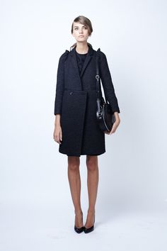 Terribly intriguing cut (observe the little jutted-out notch at the waist). #prefall2012 #carven #paris