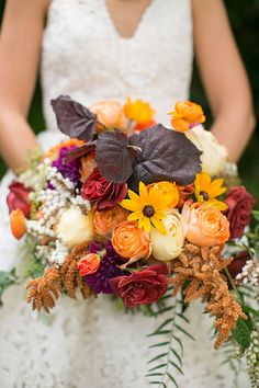 Fall-Inspired Bouquet of Dahlias, Roses, and Black-Eyed Susans | Brides.com