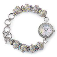 Aurora Borealis Bracelet Watch aurora-borealis crystals circling its mother-of-pearl dial;: a series of eight crystal-encrusted baubles, in turn spaced with larger, faceted-crystal rings with stainless-steel back and precision quartz movement. Silverplated