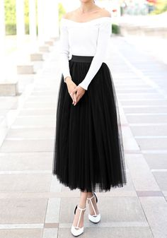 Channel your inner ballerina with this black tulle midi skirt. It has an elastic waistband and a skirt length that drops mid-ankle for a dramatic flair. Wearing this and a crop top can make you look classy in an effortless way. | Lookbook Store Date Night Fashion