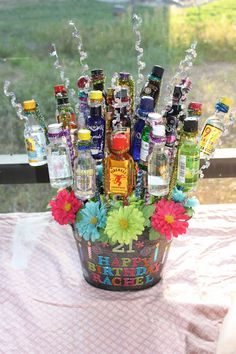 Birthday bouquet...smokes, liquor bottles, lottery tickets