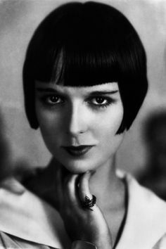 The Look: Bangs A Girl in Every Port Forehead fringe came of age in 1924, when Louise Brooks co-opted the style. The silent film star was the first American to dance the Charleston in London—and she made bangs and her signature bob an international affair in the process.