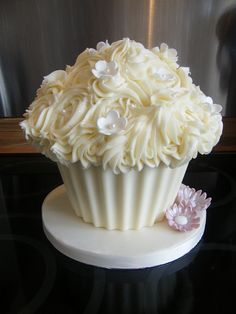 I have a giant cupcake mold..we could do a giant cupcake with little cupcakes and mini cupcakes all around. Different flavors