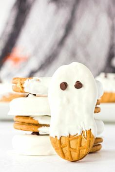 Ghost cookies made with Nutter Butters, candy melts, and chocolate chips are both super cute and super yummy. A perfect treat to make with the kids! Ghost cookies are such a fun activity to make (and eat!) with your kids. Only three simple ingredients and no baking necessary. Heck, have your middle schoolers whip up a batch as a home-ec project! Serve them after a yummy lunch of (blood red) tomato soup. Yummy!