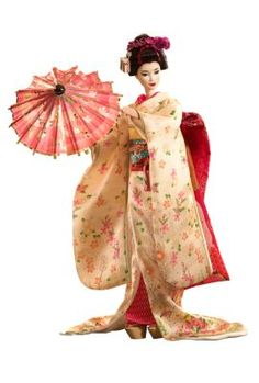 """Maiko™ Barbie® - Inspired by Japanese customs that started centuries ago, Maiko™ Barbie® represents the """"flower and willow world"""" that is geisha society. Her bright kimono has long, flowing sleeves and her wide, elaborate obi ties in the front. With white make-up, a traditional hairstyle, white socks and Japanese sandals, she's the picture of femininity."""