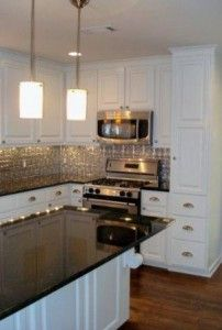 Tin Backsplash, White Cabinets, U0026 Stainless Steel Appliances U003c3