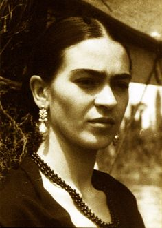 Intriguing photo of Frida Kahlo in thought.