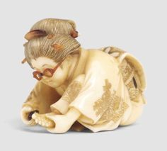 A Wood and Coral Netsuke of a